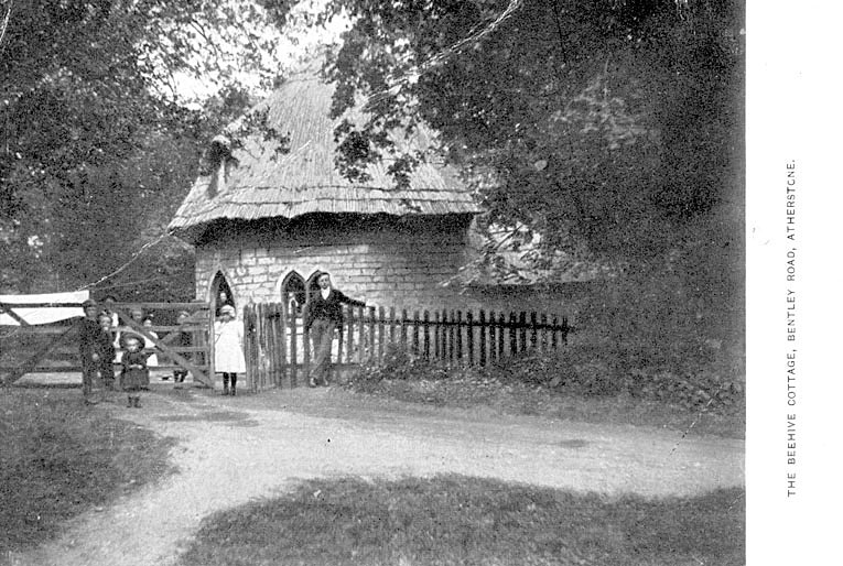 The Beehive Cottage, Atherstone with a man and group of children standing at the gate.  1900s |  IMAGE LOCATION: (Warwickshire County Record Office)