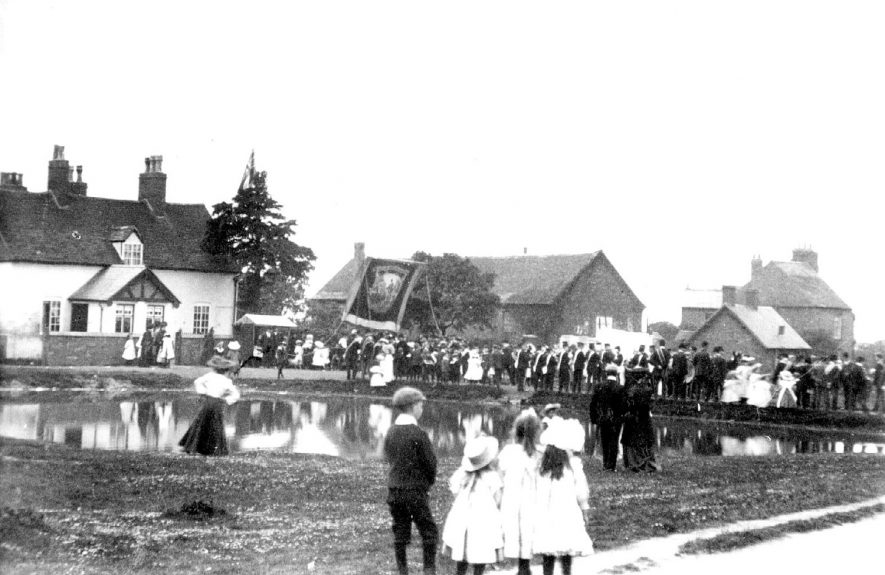 Club Day procession with banner, Baxterley.  1900s |  IMAGE LOCATION: (Warwickshire County Record Office)