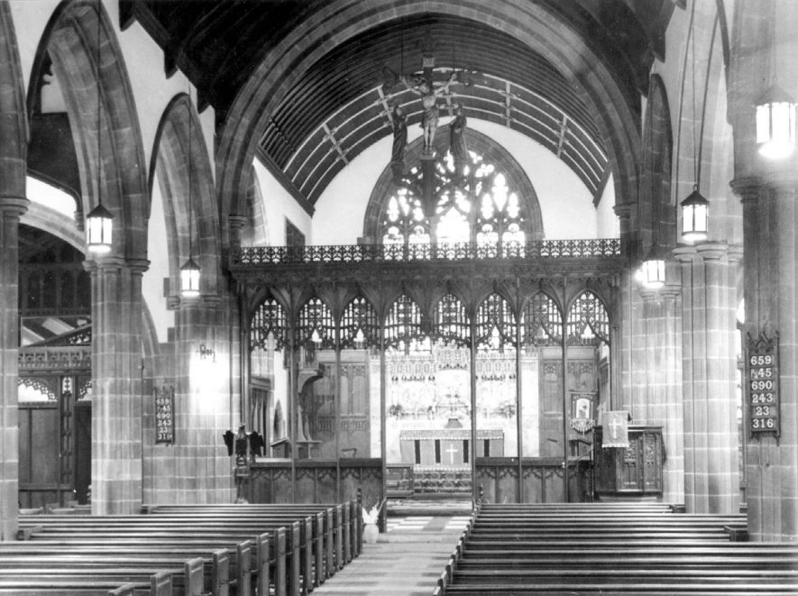 The interior of the parish church looking east showing the rood screen and cross.  1950s |  IMAGE LOCATION: (Warwickshire County Record Office)