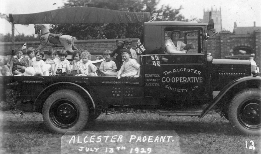 Alcester Coop Society van with children in the back, during the Alcester Pageant.  July 1929 |  IMAGE LOCATION: (Warwickshire County Record Office)