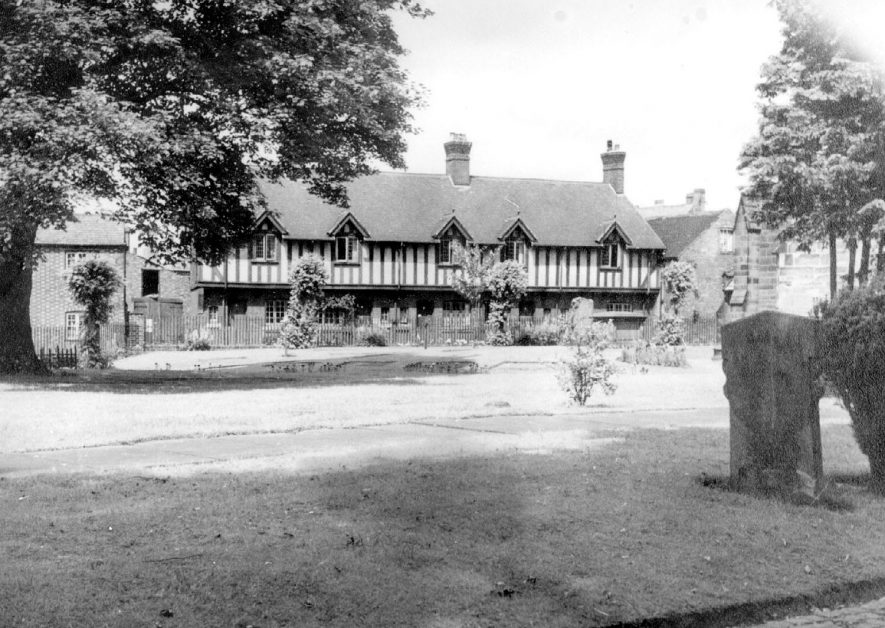 Timber framed housing in All Saints Terrace, Bedworth taken from the graveyard.  1950s |  IMAGE LOCATION: (Warwickshire County Record Office)