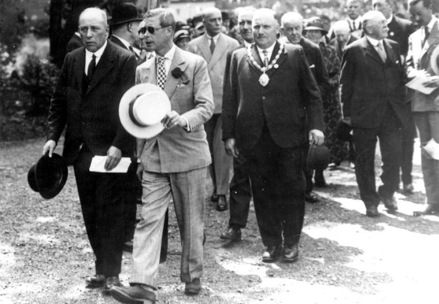 Visit to Bedworth by Edward, Prince of Wales. 1934[To the left of the Prince of Wales is William Johnson, the son of William Johnson MP. To the right of the Prince of Wales is Dr Orton(in the background) and then Teddy Tyler, Chairman of the Council] |  IMAGE LOCATION: (Warwickshire County Record Office) PEOPLE IN PHOTO: Edward, Prince of Wales