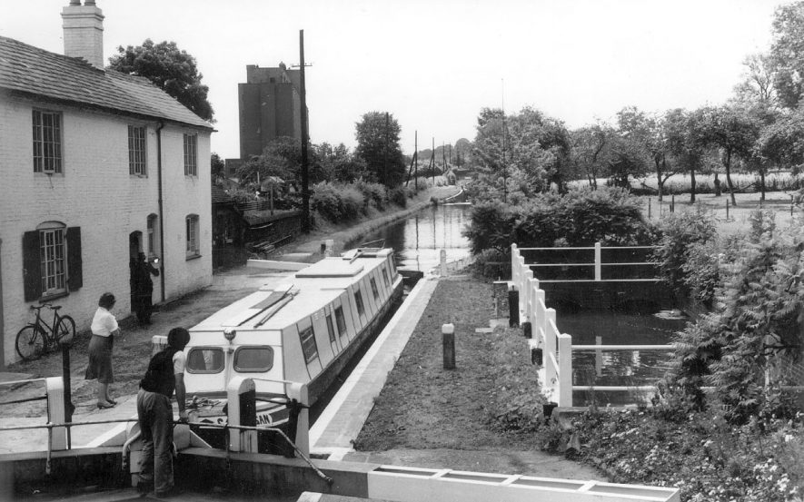 Canal, lock and lock cottage with narrow boat converted for holiday use, Atherstone.  1960s |  IMAGE LOCATION: (Warwickshire County Record Office)