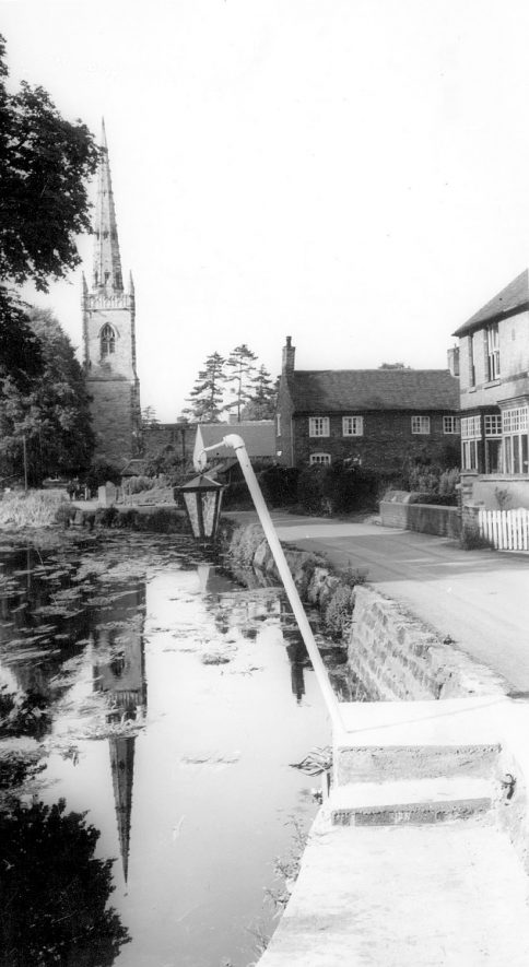 River Anker, parish church and houses by landing place, Witherley, near Atherstone.  1960s    IMAGE LOCATION: (Warwickshire County Record Office)