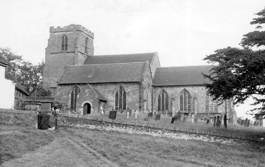 Exterior of St Peter's Church and churchyard, Mancetter.  1960s |  IMAGE LOCATION: (Warwickshire County Record Office)