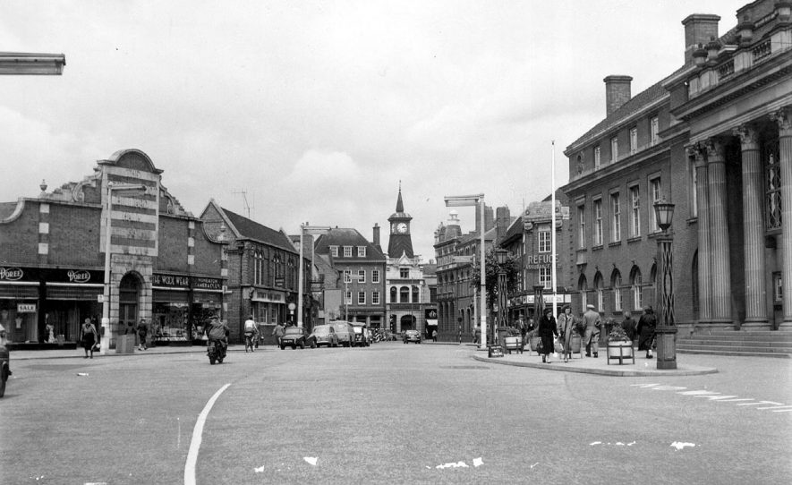 Nuneaton, Market Place with shops, town hall and vehicles.  1960s |  IMAGE LOCATION: (Warwickshire County Record Office)