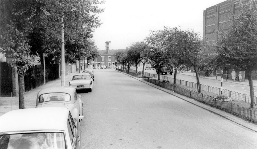Newtown Road close to the original junction with Abbey Street. The side of the Ritz Cinema is on the right. This road is now part of Roanne Ringway. The terraced house at the end of the road are in Graham Street. 1960s    IMAGE LOCATION: (Warwickshire County Record Office)