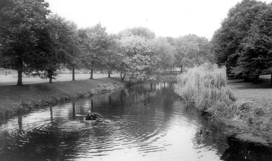 Child boating on the water at Riversley Park.  1960s |  IMAGE LOCATION: (Warwickshire County Record Office)