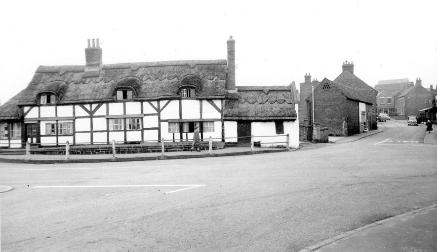 Polesworth Market Place showing a fine thatched and half timbered house.  1950s |  IMAGE LOCATION: (Warwickshire County Record Office)