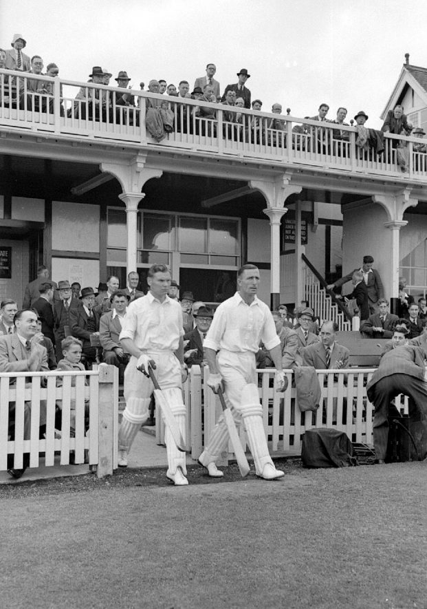 The Middlesex opening pair, Jack Robertson and Sidney Brown take the field at the start of the match,  Edgbaston.  Saturday July 8th 1950 |  IMAGE LOCATION: (Warwickshire County Record Office) PEOPLE IN PHOTO: Robertson, Jack, Robertson as a surname, Brown, Sidney, Brown as a surname
