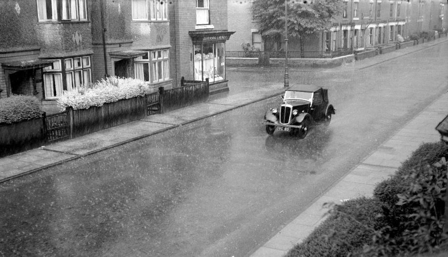 A rainy day in Edward Street, Nuneaton.  Showing semi-detached houses and one car.  1950 |  IMAGE LOCATION: (Warwickshire County Record Office)