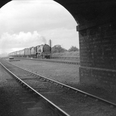 Nuneaton.  Gipsy Lane, bridge with express train