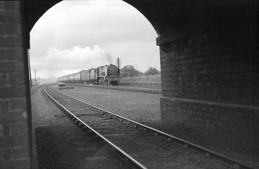 An express (steam) travelling north from Euston, about to pass under Gipsy Lane Bridge, Nuneaton.  Loco 46134,