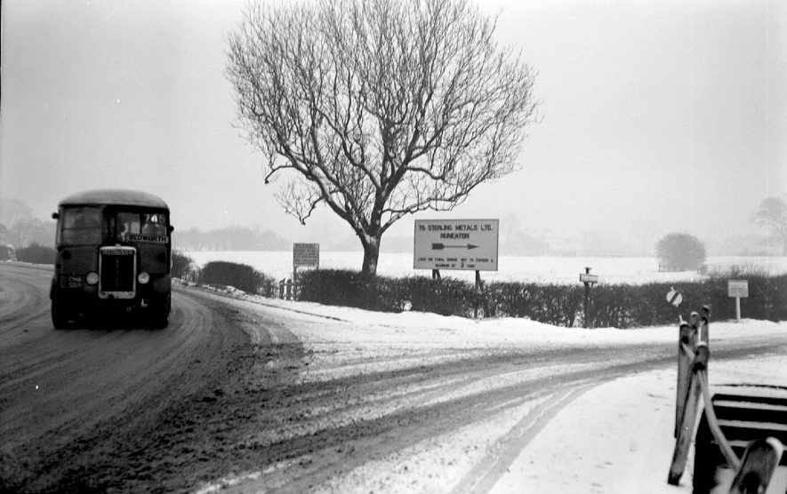 Gipsy Lane, Nuneaton, in the snow with a bus passing.  1950    IMAGE LOCATION: (Warwickshire County Record Office)