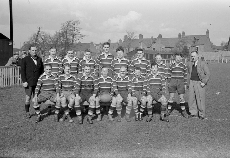 Nuneaton R.F.C. (19 pts.)  v. Old Alleynians R.F.C. (8 pts). Team photograph before the match showing, back row: A. Thomas, Dr McFarlane, O.G. Wheeler, J. Deeming, R. Moufill, D. Collard, D. Claridge, I. Jones, R. Townsend, R. Warmington. Front row: H. Pateman, R. Gale, W.A. Holmes, A. Gale, W.S. Holmes, D. Sphoul, N. Holmes.  New Inn Ground, Attleborough Road, Nuneaton.  1951 |  IMAGE LOCATION: (Warwickshire County Record Office) PEOPLE IN PHOTO: Wheeler, O G, Wheeler as a surname, Warmington, R, Warmington as a surname, Townsend, R, Townsend as a surname, Thomas, A, Thomas as a surname, Sphoul, D, Sphoul as a surname, Pateman, H, Pateman as a surname, Moufill, R, Moufill as a surname, McFarlane, Dr, McFarlane as a surname, Jones, I, Jones as a surname, Holmes, W S, Holmes, W A, Holmes, N, Holmes as a surname, Gale, R, Gale, A, Gale as a surname, Deeming, J, Deeming as a surname, Collard, D, Collard as a surname, Claridge, D, Claridge as a surname
