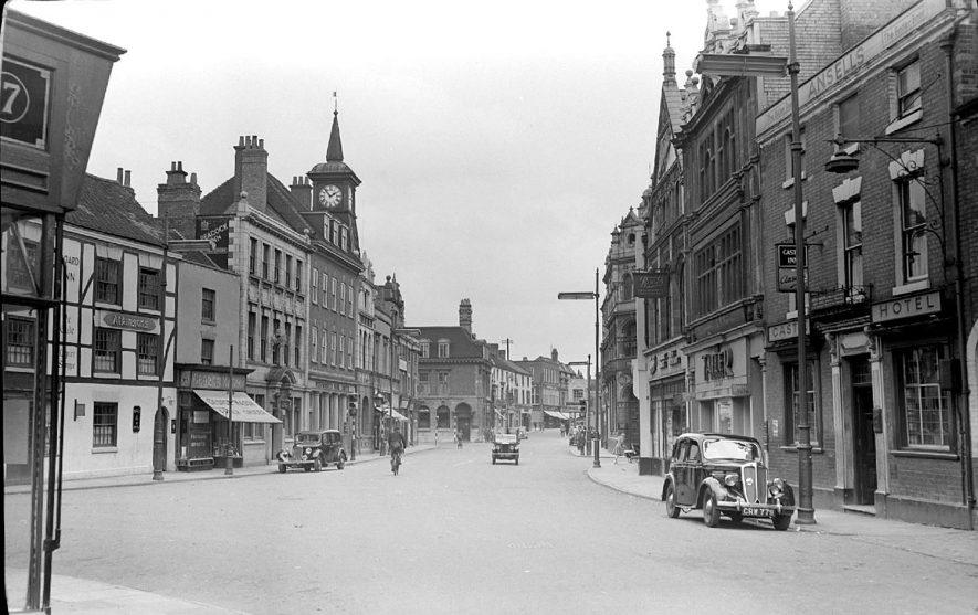 Nuneaton Market Place showing shops and cars.  1951 |  IMAGE LOCATION: (Warwickshire County Record Office)