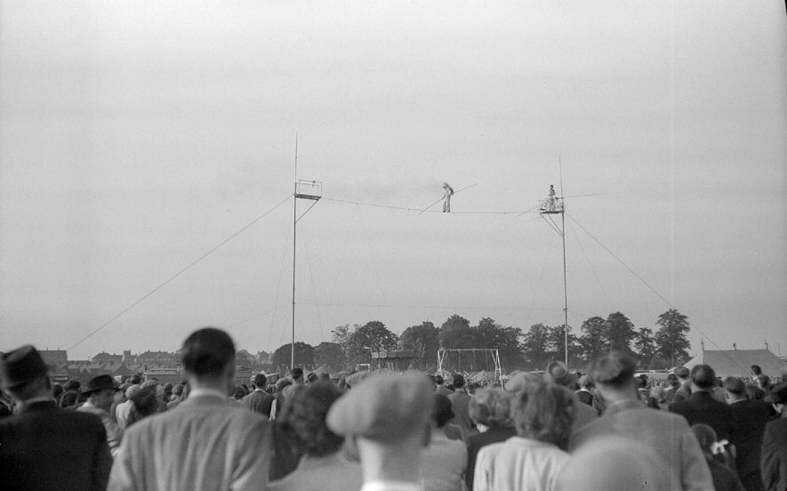Evening entertainment in the Pingle Fields with a trapeze artist on the high wire, Nuneaton.  1951 |  IMAGE LOCATION: (Warwickshire County Record Office)