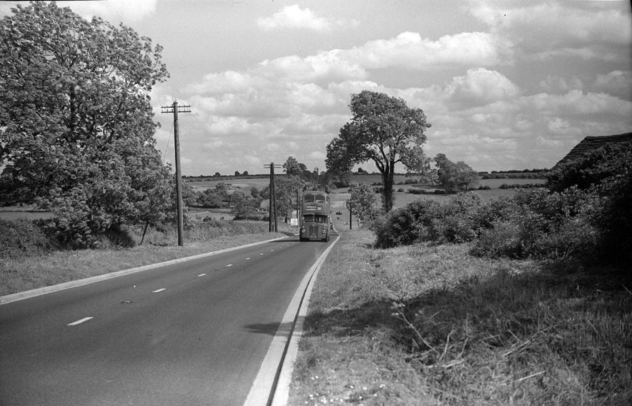 View of Smockington Hollow on the A5, looking south,  with a Midland Red double deck bus, Nuneaton.  1951 |  IMAGE LOCATION: (Warwickshire County Record Office)
