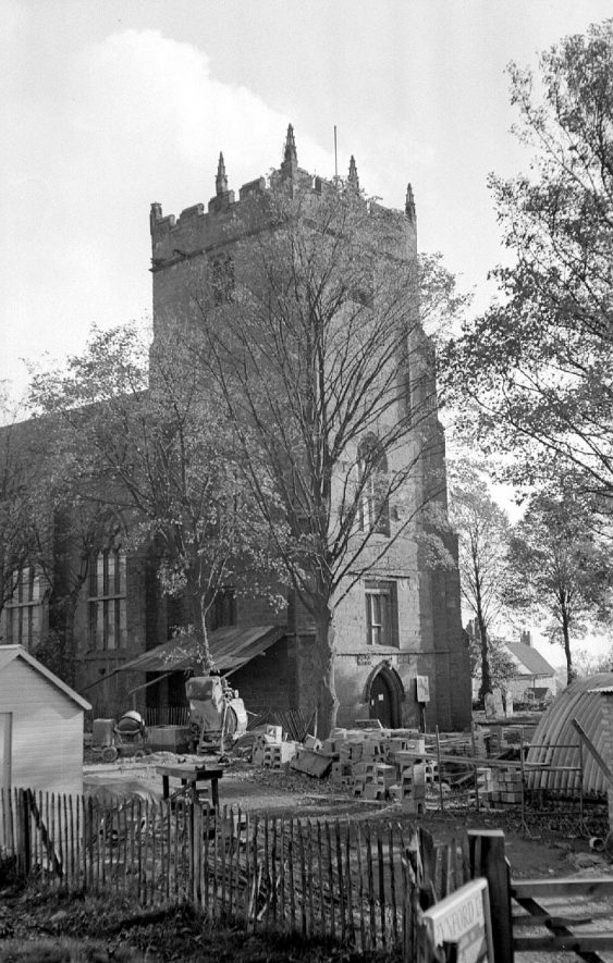 View of Astley church during the underpinning operations by the National Coal Board.  1951 |  IMAGE LOCATION: (Warwickshire County Record Office)