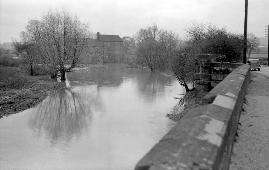 Sheepy Lane, Atherstone, and the River Anker after heavy rain, showing part of the road bridge.  1951 |  IMAGE LOCATION: (Warwickshire County Record Office)