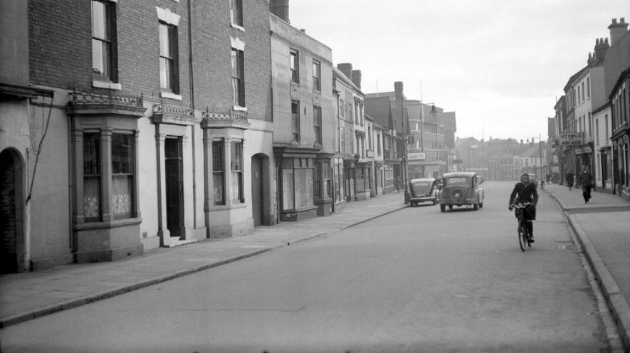 Looking down Abbey Street towards the Ritz cinema.  On the extreme left is the house used in the 30's by Dr A.A. Wood as his surgery, Nuneaton.  1951 |  IMAGE LOCATION: (Warwickshire County Record Office)