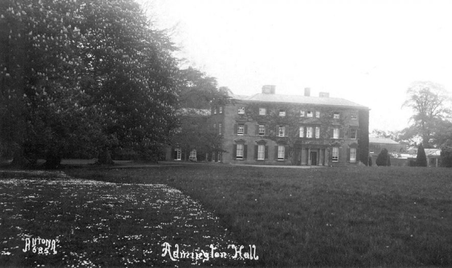 Admington Hall with out building and greenhouses. 1920s |  IMAGE LOCATION: (Warwickshire County Record Office)