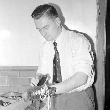 Nuneaton.  John Deeming, cleaning his boots