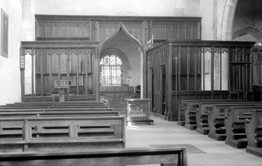 View of the interior of the church at Wootton Wawen, taken from the nave looking towards the central tower and  to the chancel beyond.  1955 |  IMAGE LOCATION: (Warwickshire County Record Office)