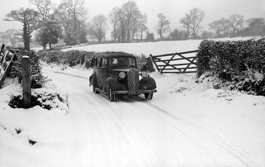 Vauxhall car belonging to Mr H.S. Bull (registration number BNX 764) pictured in the snow near Astley, Nuneaton.  1956 |  IMAGE LOCATION: (Warwickshire County Record Office)
