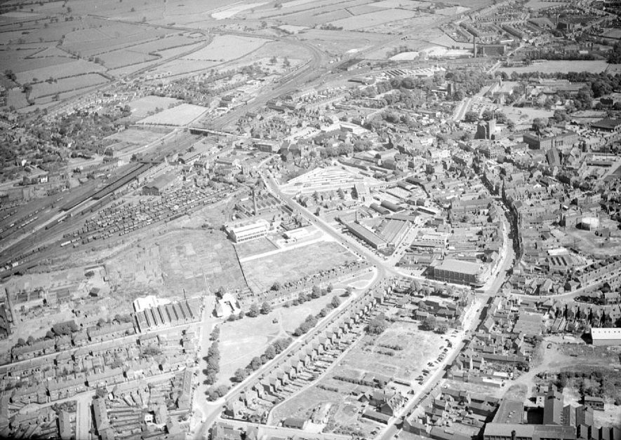 Aerial view of Nuneaton with Abbey Street on the right and Corporation Street on the left.  The Ritz cinema can be seen on the right of this photograph.  1957 |  IMAGE LOCATION: (Warwickshire County Record Office)
