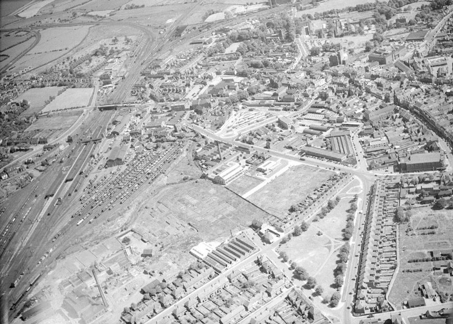 Aerial view of Nuneaton with Corporation Street in the lower right, with the 'Ritz' cinema, centre right.   The new Bus Station in the centre.  1957 |  IMAGE LOCATION: (Warwickshire County Record Office)