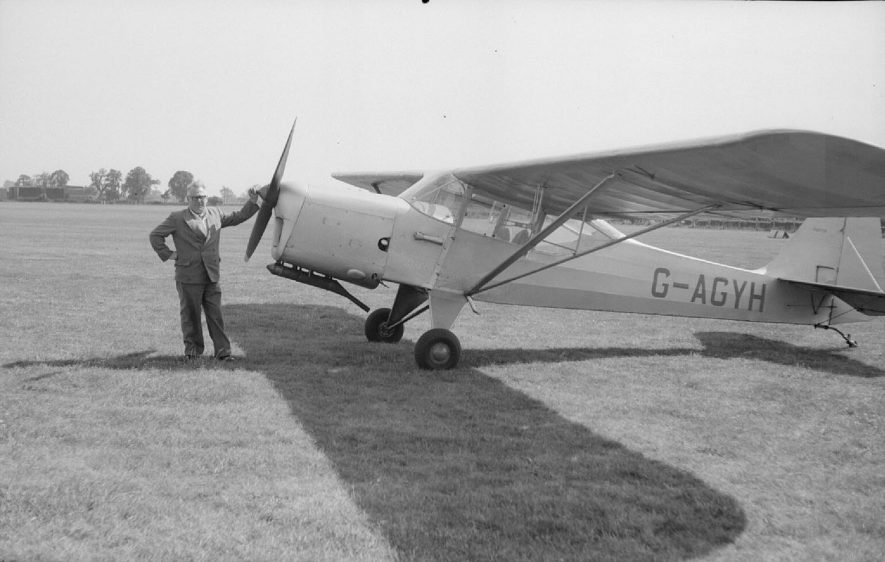 Mr W.J. Taylor,  a garage proprietor from Charles Street, Nuneaton, with the Auster aeroplane at Baginton Airport, on 15th June 1957, the day he took Mr Reg Bull to take aerial photographs of Coventry and Nuneaton. |  IMAGE LOCATION: (Warwickshire County Record Office) PEOPLE IN PHOTO: Taylor, Mr W J also known as Billy, Taylor as a surname