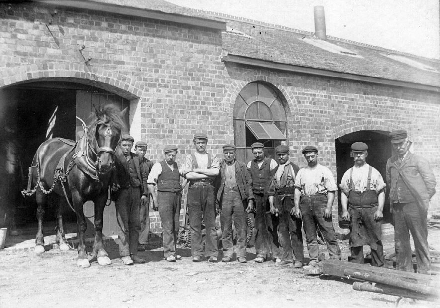 Group of workers outside Stanley's Pit, Nuneaton. Mr Samuel Jones, farrier is second from the right.  c.1890 |  IMAGE LOCATION: (Nuneaton Library) PEOPLE IN PHOTO: Jones, Samuel, Jones as a surname