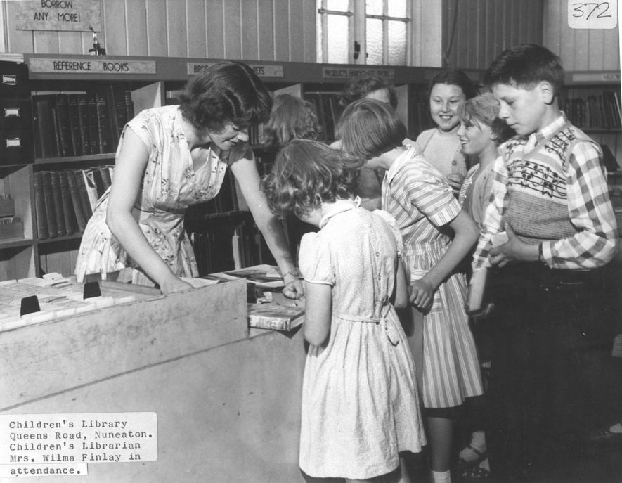 The children's library in Queen's Road, Nuneaton with the children's librarian, Mrs Wilma Finlay in attendance.  1950s |  IMAGE LOCATION: (Nuneaton Library) PEOPLE IN PHOTO: Finlay, Wilma, Finlay as a surname