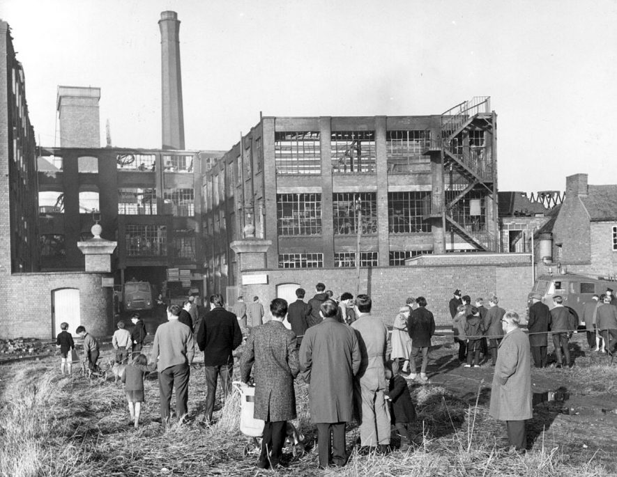 The Awson Carriage Works fire, Nuneaton, December 1967.  Photograph taken the following morning showing crowd viewing gutted building. |  IMAGE LOCATION: (Nuneaton Library)