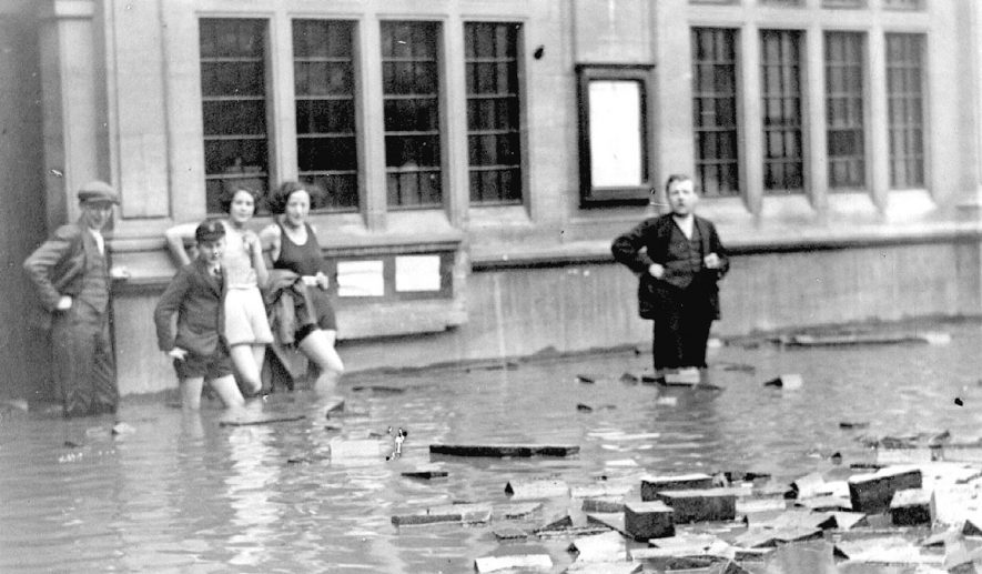 Floods in Market Place, Nuneaton on May 22nd 1932.  Post Office in the background. |  IMAGE LOCATION: (Nuneaton Library)