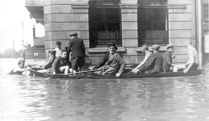 Floods in the Market Place, outside the National Provincial Bank, on 22nd May 1932. |  IMAGE LOCATION: (Nuneaton Library)