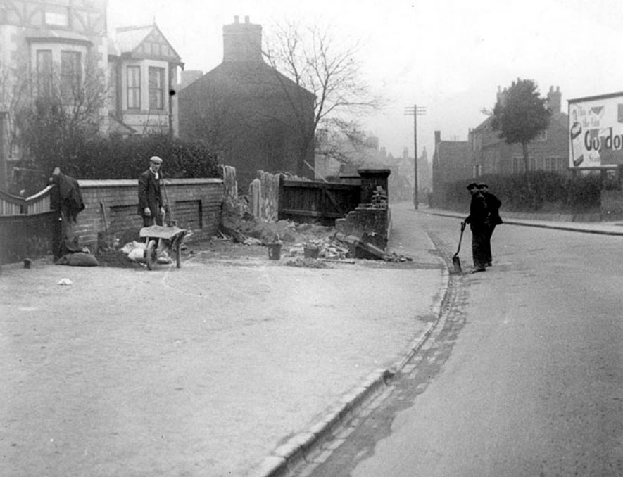 Workmen repairing a wall at the junction of Lutterworth road and Highfield road, Nuneaton.  1920s |  IMAGE LOCATION: (Nuneaton Library)