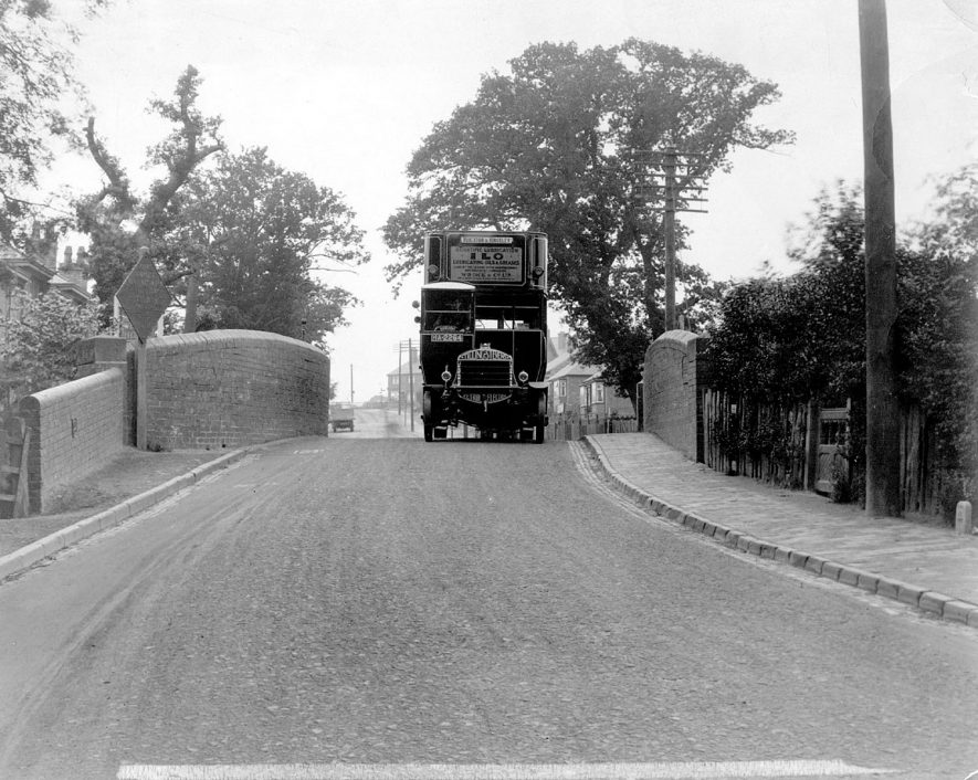 A Tilling Stevens omnibus on the Coventry Road. This picture is looking towards Hill Top and was taken before the bridge widening, Nuneaton.  1920s |  IMAGE LOCATION: (Nuneaton Library)