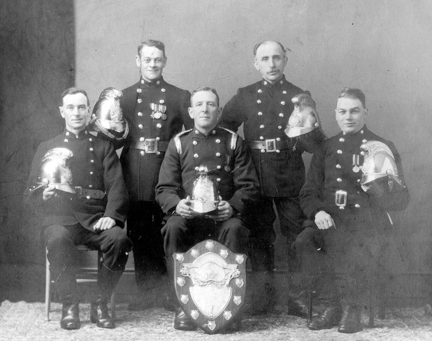 Group of Nuneaton Firemen.  The central figure is Captain Tommy Ellis.  9128 |  IMAGE LOCATION: (Nuneaton Library) PEOPLE IN PHOTO: Ellis, Tommy, Ellis as a surname