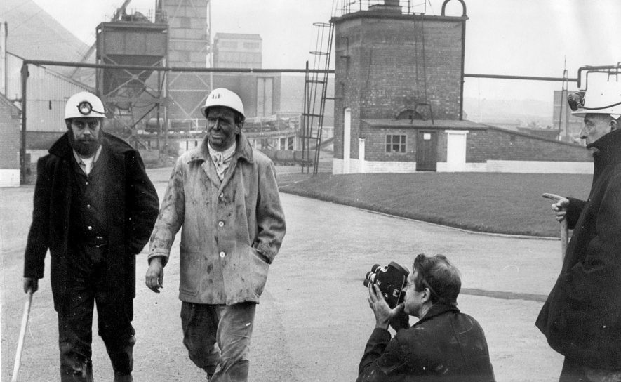 Mr L. Huckfield M.P. for Nuneaton & Bedworth filmed by a German T.V. unit as he leaves Newdegate Pit, Bedworth with the manager.  1968 |  IMAGE LOCATION: (Nuneaton Library) PEOPLE IN PHOTO: Huckfield, Mr L M P, Huckfield as a surname