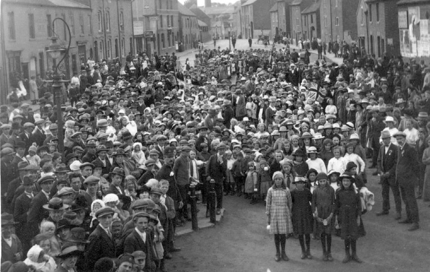 A large gathering of people for a celebration in Atherstone.  1920 |  IMAGE LOCATION: (Warwickshire County Record Office)