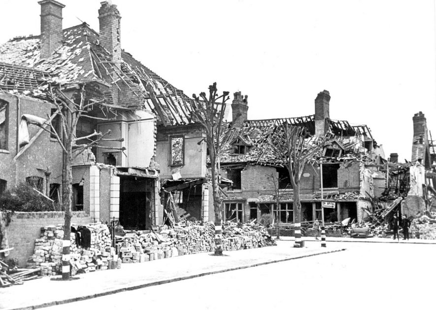 Wartime bomb damage in Manor Court Road, looking from Manor Court Avenue and facing away from Manor Hospital, Nuneaton.  1940s |  IMAGE LOCATION: (Nuneaton Library)