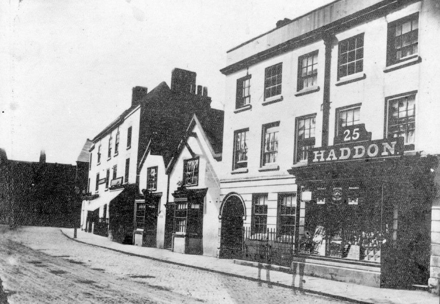 Shops, including Haddons, and houses in Market Place, Nuneaton.  1870s |  IMAGE LOCATION: (Nuneaton Library)
