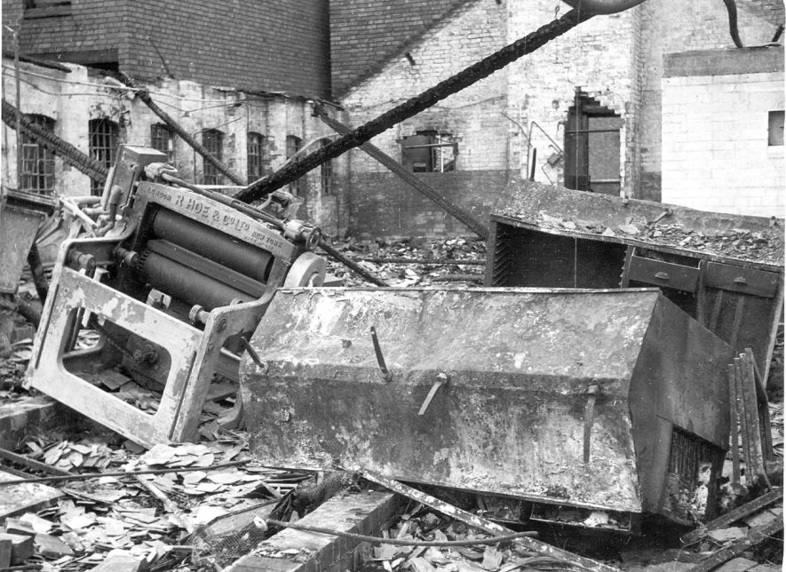 Bomb damage at Midland Daily Tribune premises, showing damaged moulding press and type cabinets, Nuneaton.  1940s |  IMAGE LOCATION: (Nuneaton Library)