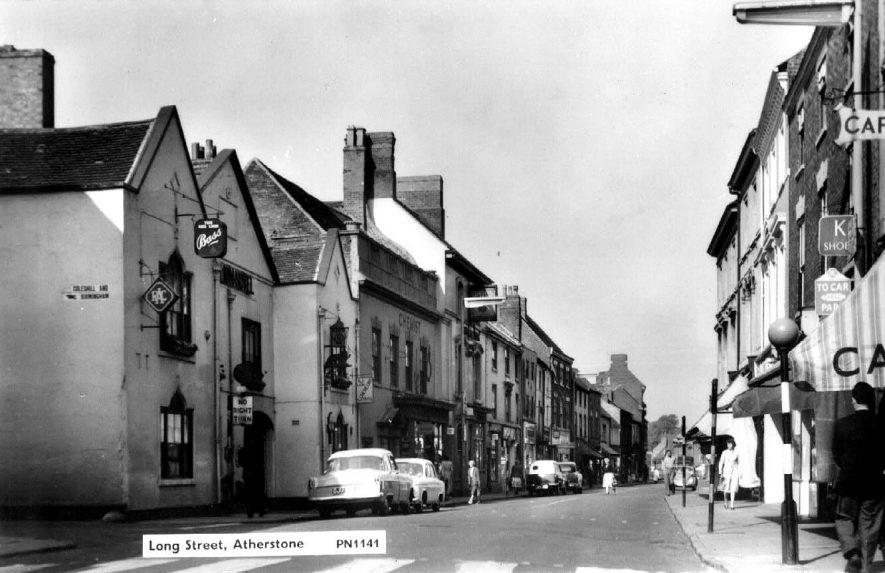 Long Street, Atherstone, showing parked cars and pedestrian crossing.  1964 |  IMAGE LOCATION: (Warwickshire County Record Office)