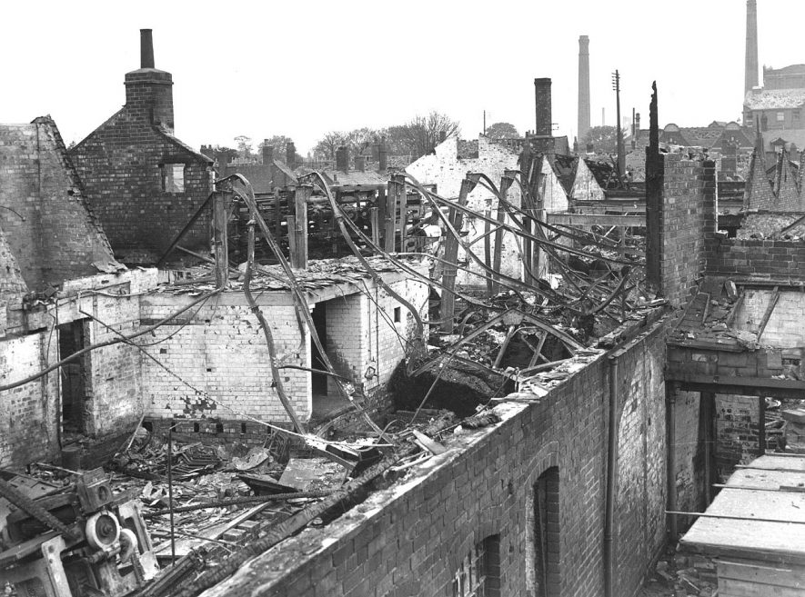 Bomb-damaged Midland Daily Tribune building, taken from Vicarage Street, Nuneaton.  Old mill (with chimney) right.  Courtauld's Tower (with clock) on skyline.  1940s |  IMAGE LOCATION: (Nuneaton Library)