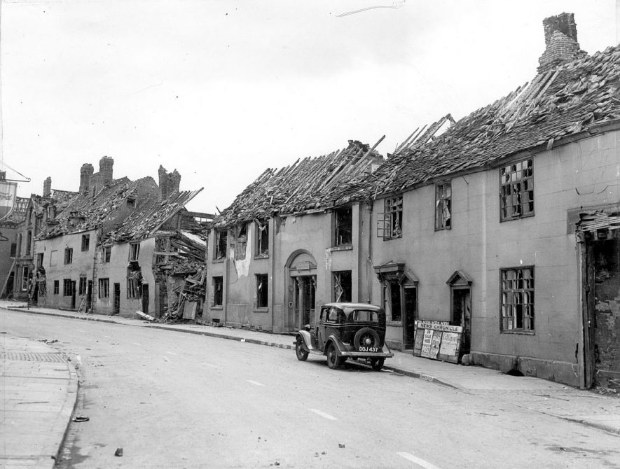 Bomb damage in Church Street, Nuneaton.  Lawyer Dempster's house, centre.  1940s |  IMAGE LOCATION: (Nuneaton Library)