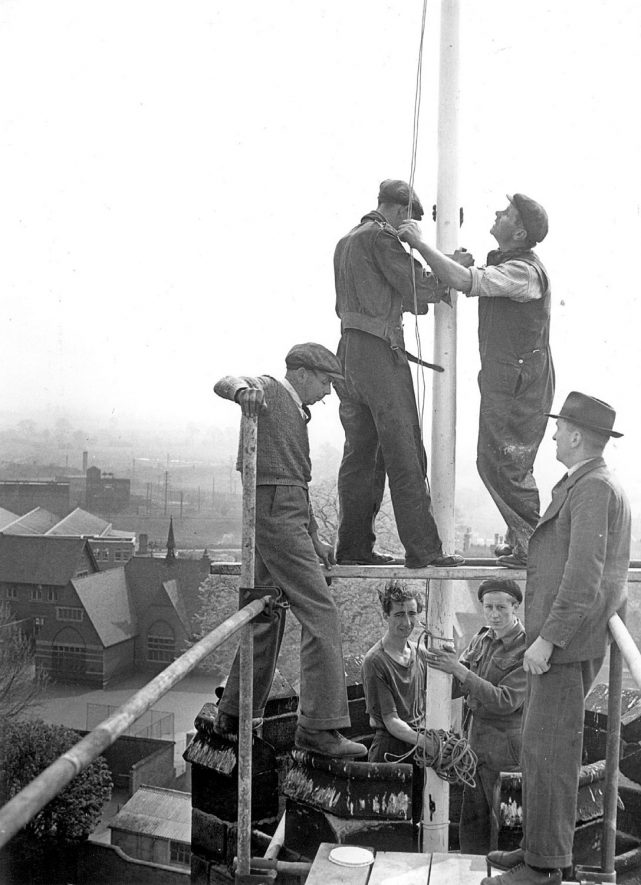 St Nicholas Church, Nuneaton.  Workers erecting new flagpole. Mr. A. Turner, verger, on right.  1953 |  IMAGE LOCATION: (Nuneaton Library) PEOPLE IN PHOTO: Turner, A, Turner as a surname