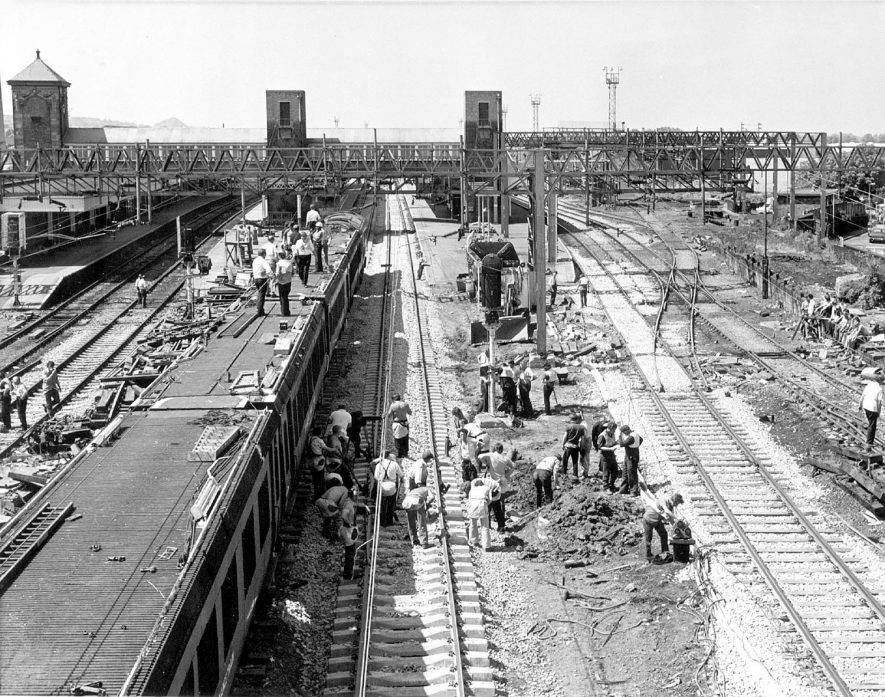 Photograph taken on 11 June 1975 showing the overhead cables being replaced at Trent Valley Station. |  IMAGE LOCATION: (Nuneaton Library)